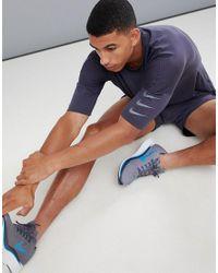 Tailwind Run Division di Nike in Gray da Uomo