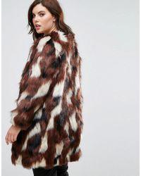 Manteau patchwork en fausse fourrure Elvi en coloris Brown