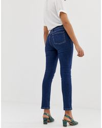 Jeans skinny modellanti lavaggio medio di Warehouse in Blue