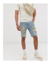 Shorts vaqueros ajustados con lavado claro y roturas marcadas ASOS de hombre de color Blue