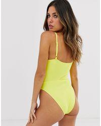 Unqiue21 - Costume da bagno a coste smerlato con nodo davanti di UNIQUE21 in Yellow