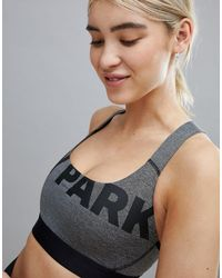 Active - Soutien-gorge avec logo Ivy Park en coloris Gray