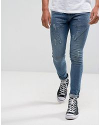 ASOS Super Skinny Jeans In Mid Wash Blue With Lightning Bolt Detail for men