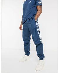 Lock Up - Joggers blu navy con logo di Adidas Originals in Blue da Uomo