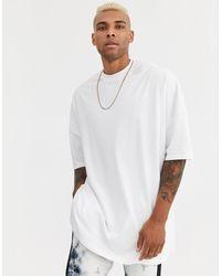 Camiseta muy larga y extragrande en blanco con aberturas laterales ASOS de hombre de color White