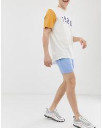 Pantaloncini skinny in jersey blu di ASOS in Blue da Uomo