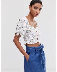 Top d'été boutonné à fleurs style milkmaid Fashion Union en coloris White