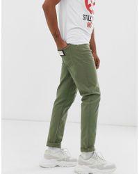 Vaqueros de corte slim en verde Love Moschino de hombre de color Green