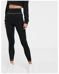 Leggings con costuras en contraste y cinturilla ancha ASOS de color Black