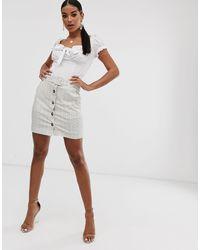 Minigonna a quadri con bottoni e cintura bianco sporco di NA-KD in Natural