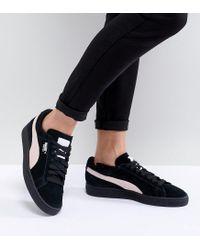 meet 8ecfc 4ea9e Women's Suede Classic Sneakers In Black With Pink Branding