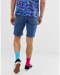 Shorts vaqueros ajustados en azul Collusion de hombre de color Black