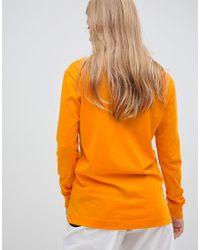 Maglietta a maniche lunghe con logo arancione di Nike in Orange