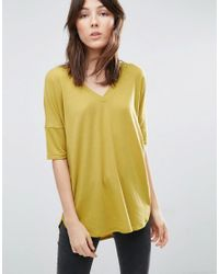 ASOS | Yellow Oversized T-shirt With V Neck And Dip Back In Rib | Lyst