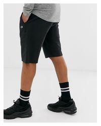 Pantalones cortos negros con diseño más largo Reverse Weave Champion de hombre de color Black