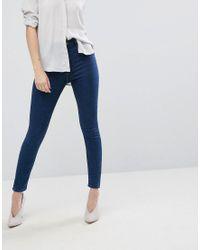 Jeans skinny a vita alta lavaggio Clemence di ASOS in Blue