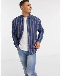 Camisa vaquera extragrande estilo años 90 con diseño ASOS de hombre de color Blue