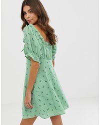 Minivestido con escote en forma de corazón y estampado de flores ASOS de color Green