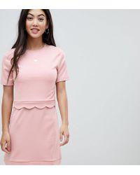 Minivestido con el bajo festoneado y detalle de top corto ASOS de color Pink