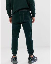 Joggers verdi con cuciture a contrasto di Pull&Bear in Green da Uomo