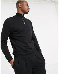 Chándal con sudadera con media cremallera y joggers plisados en negro ASOS de hombre de color Black