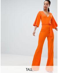 Tuta jumpsuit con cintura di Missguided in Orange