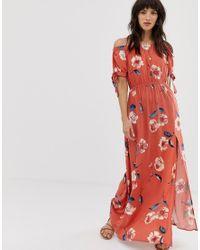 Vestido largo con escote Bardot, lazada en las mangas y estampado floral rojo Band Of Gypsies de color Red