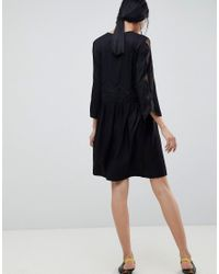 Anne - Robe à empiècements en dentelle Gestuz en coloris Black