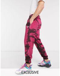 Classics - Joggers tie-dye rosa e neri di Reebok in Red da Uomo