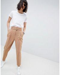 Pantaloni stretti in fondo con cintura e fibbia di ASOS in Multicolor
