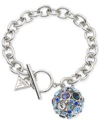 Guess | Metallic Rhodium-tone Fireball Blue Crystal Charm Bracelet | Lyst