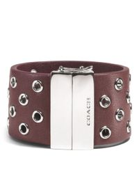 COACH Red Hinged Leather Grommet Bangle