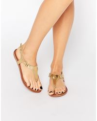 fc1ac2903e08 ALDO Ashley Gold Ankle Fastener Thong Sandals - Gold in Natural - Lyst