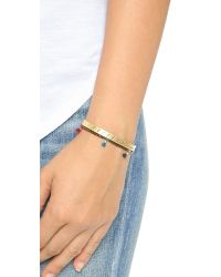 Madewell - Metallic Engraved X Bangle Bracelet - Vintage Gold - Lyst
