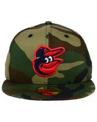 cheaper 0ac8e 710b2 Men s Green Baltimore Orioles Under Woodland 59fifty Cap