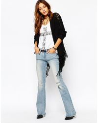 Blank Blue Flared Jeans With Raw Hem And Distressing