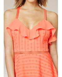 Bebe - Orange Ruffled Cross Back Dress - Lyst