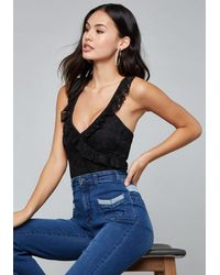 Bebe - Black Lace Cross Ruffle Bodysuit - Lyst