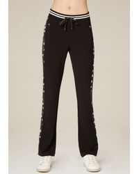 Bebe | Black Side Striped Track Pants | Lyst