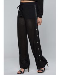 Bebe - Black Logo Mesh Side Snap Pants - Lyst