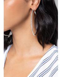 Bebe Metallic Silver Twist Hoop Earrings