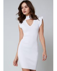40f608a136 Bebe Lace Up Sweater Dress in White - Lyst