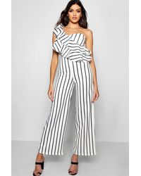 6e3c1fe8585 Boohoo One Shoulder Ruffle Wide Leg Jumpsuit in White - Lyst