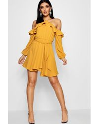 b199926c3a1d Boohoo Wrap Front Ruffle Shoulder Skater Dress in Yellow - Lyst