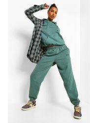 Pantalones De Deporte Holgados Sobreteñidos Ofcl Studio Boohoo de color Green