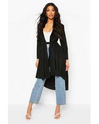 Long Manteau En Suédine À Taille Nouée Boohoo en coloris Black