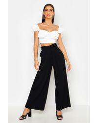 Pantalon Coupe Large Plissé Noué À La Taille Boohoo en coloris Black