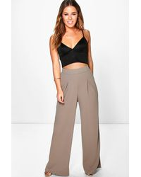 33f2702efc7e8 Boohoo Petite Wide Leg Pleat Trouser in Brown - Lyst