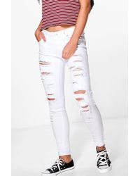 Boohoo - White Leah Ripped Low Rise Skinny Jeans - Lyst