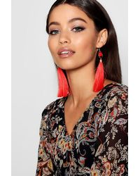 Boohoo - Red Pom And Long Tassel Earrings - Lyst